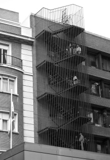Workers taking a smoking break on a fire escape