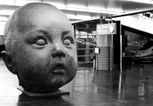 Sculpture of a child's head in Atocha Station