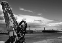Memorial anchor and West & East lighthouses, Whitby