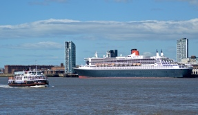 Queen Mary 2 and The Royal Iris, River Mersey, Liverpool.