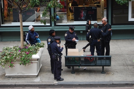 NYPD cops apprehend a street seller.