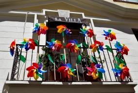 Rainbow windmills on the balcony of La Villa.