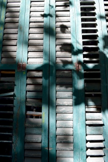 Late afternoon sun casts a shadow on these shutters