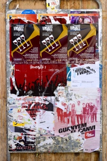 An old noticeboard being used for a number of posters