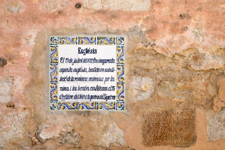 Wall tile explaining the history of the main church in Sitges