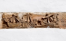 A clay wall relief showing 3 ships