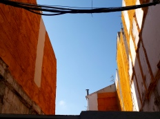 A space between two buildings, now a construction site.