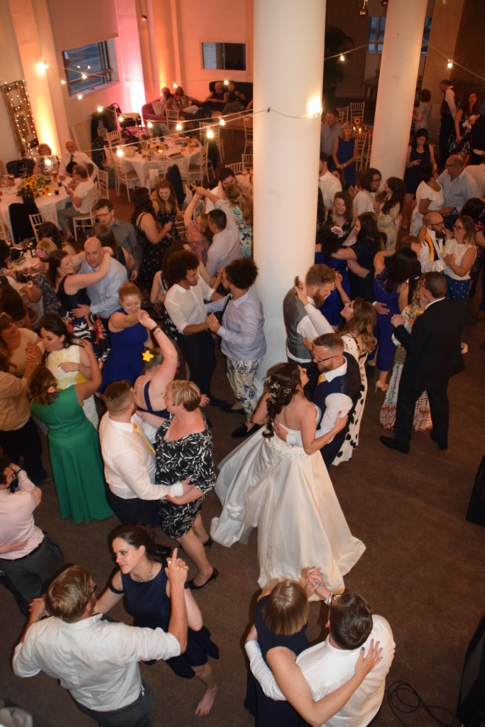Image displays a first dance at a wedding taken from a high vantage point