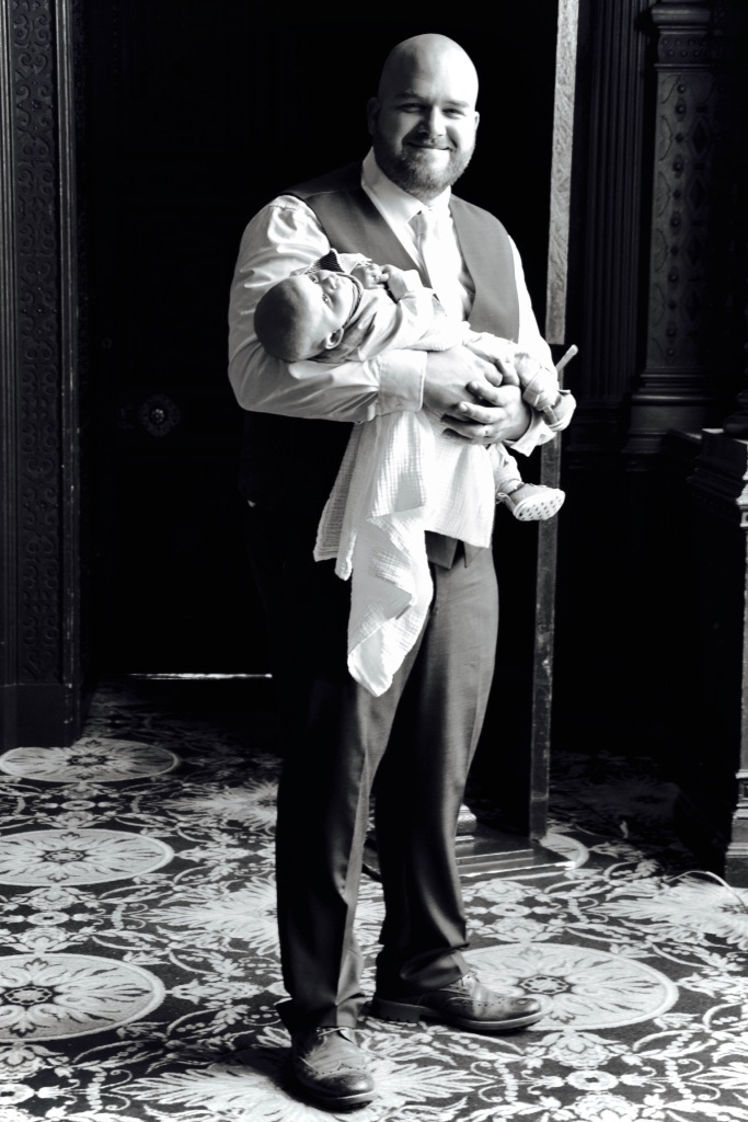 Wedding guest holding his child